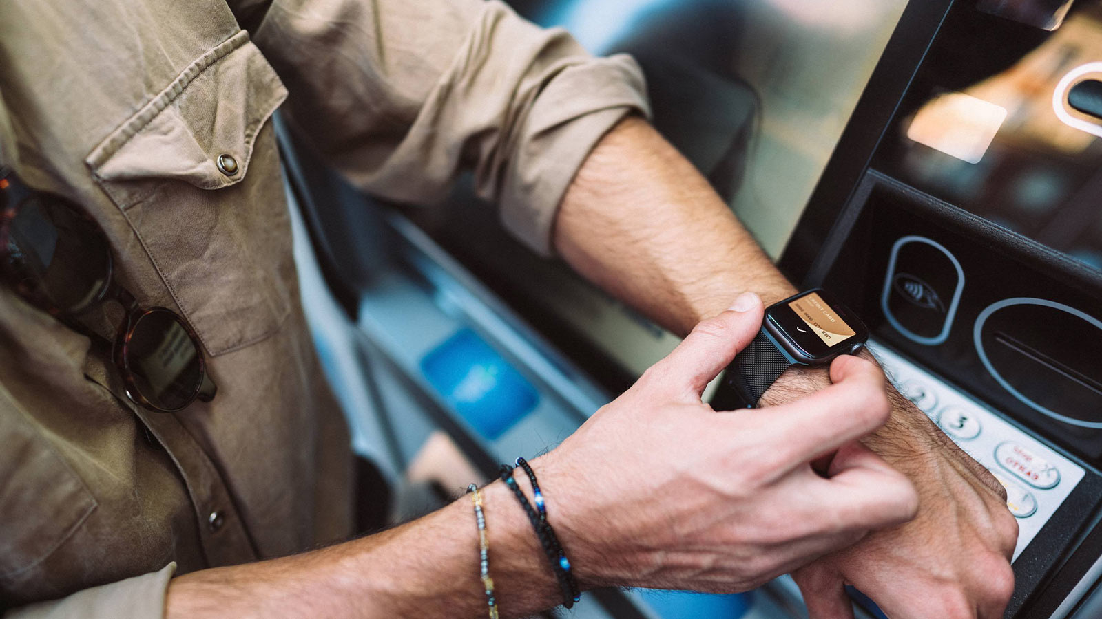 Man making a transaction with smartwatch